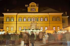 The 24 windows of the front of Hellbrunn Palace used as an Advent calendar during the town's Christmas market.